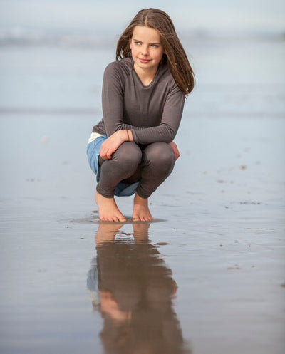 girl wearing organic merino long sleeve top
