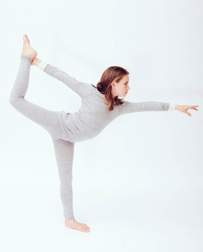 tween wearing organic merino wool top and leggings