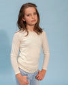 girl wearing milk coloured woolen long sleeve top