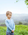 boy wearing blue merino rib top