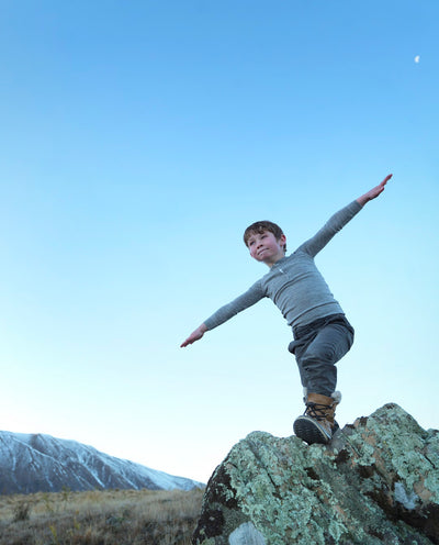boy enjoying the outdoors wearing merino top