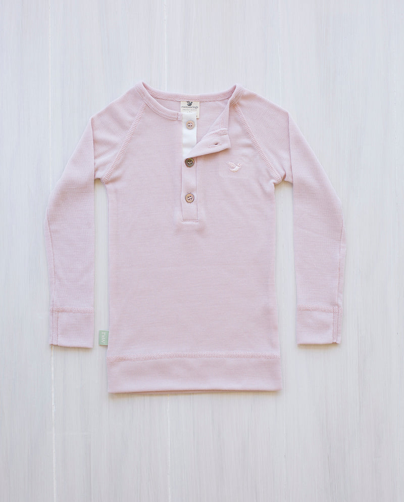 girl wearing merino junior rib top