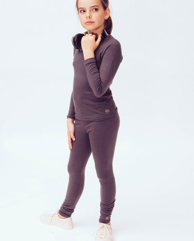 girl wearing organic merino long sleeve top and leggings