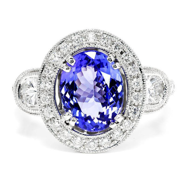 Once Upon A Diamond Ring Oval Tanzanite Halo Ring with Half Moon Diamond's 18K