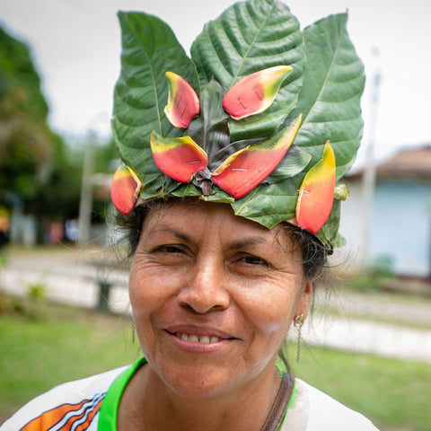 A woman with a headdress made of leaves and flowers
