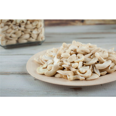 A white plate of cashews