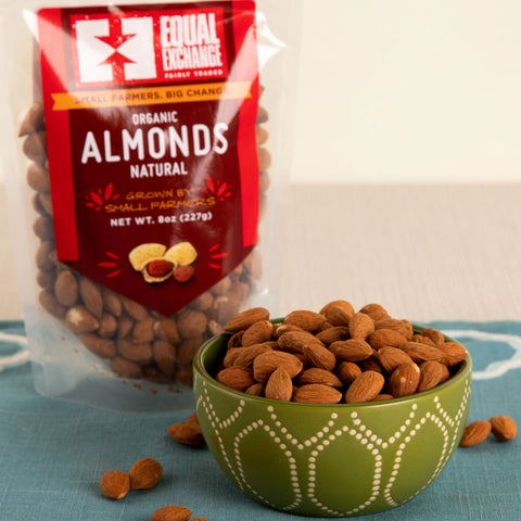 Front view of a bowl and a package of organic natural almonds