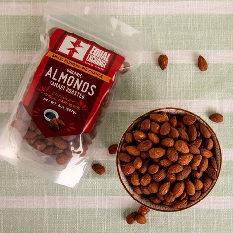 Top down view of a bowl and a package of organic tamari roasted almonds