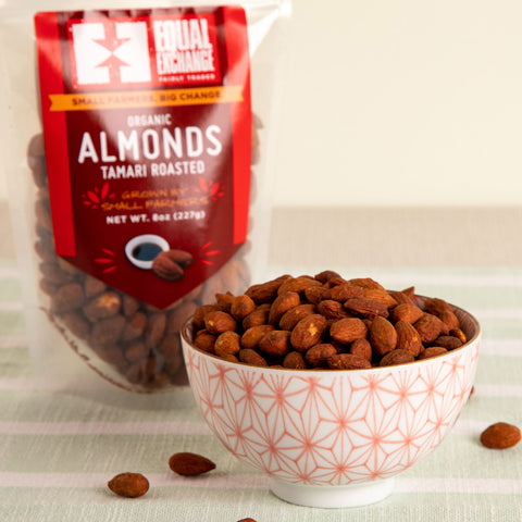 Front view of a bowl and a package of organic tamari roasted almonds