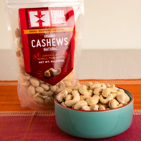 Front view of a bowl and a package of organic natural cashews