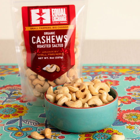 Front view of a bowl and a package of organic roasted salted cashews