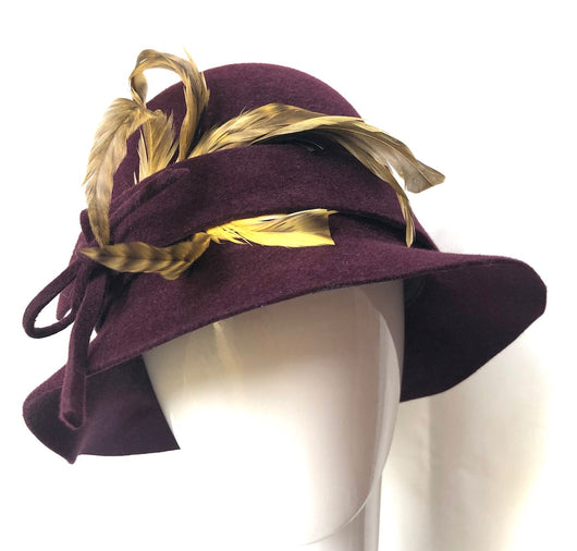 Burgundy Cloche with yellow feather bouquet
