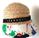 Raffia hat with 'Splash of Art' brim. Removable denim mask included. Small