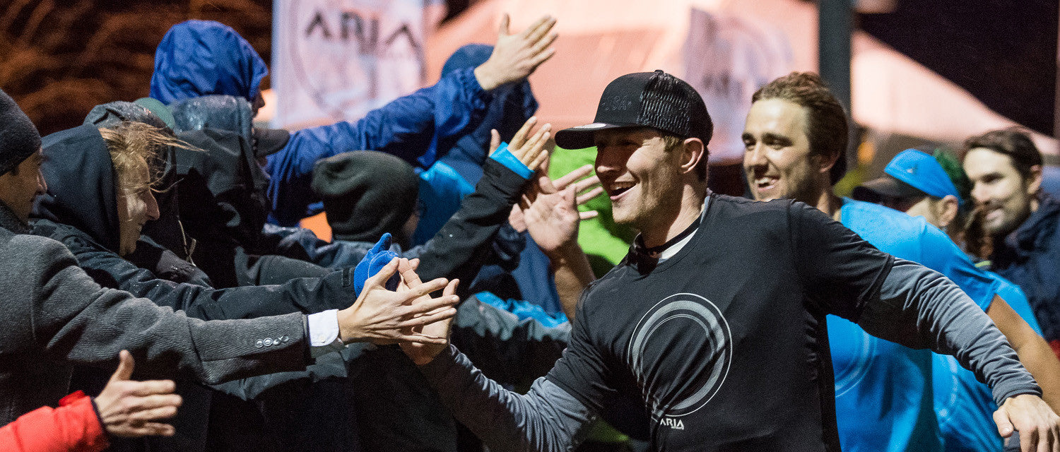 Chris Mazur leads players down a line of high-fives at the ARIA Ultimate Game of the Year.