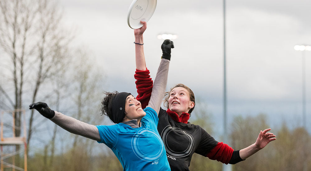 Female ultimate players vie for the disc.