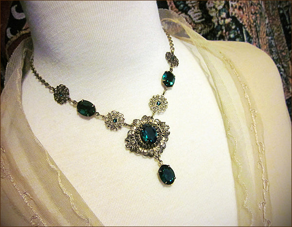 Custom Necklace in antiqued brass with swarovski emerald stones to match emerald Avalon Tiara -- designed by dosha of Rabbitwood & Reason.