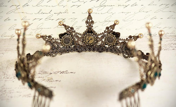 The inside of each tiara is carefully lined with antiqued metal ribbon; this attention to detail ensures Rabbitwood & Reason tiaras are aesthetically lovely from every angle, and ready for display after your special event has passed. Created by dosha of Rabbitwood & Reason.