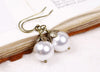 Aquitaine Pearl Drop Earrings in White Pearl - Antiqued Brass - by dosha of Rabbitwood & Reason