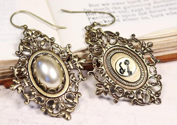 Each earring features a signature tag with Medieval key - by dosha of Rabbitwood & Reason