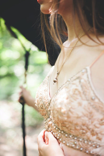 Rhiannon Pendant Necklace - Cream Pearl - Antiqued Brass - Rabbitwood & Reason - Photo: La Candella Weddings