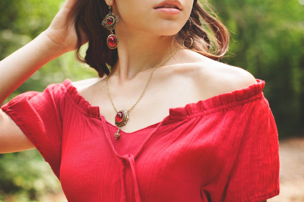 Lucia Earrings - Ruby - Antiqued Brass - Rabbitwood & Reason - Photo: La Candella Weddings