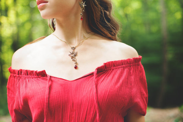 Poseidon's Steed Earrings - Ruby - Antiqued Brass - Rabbitwood & Reason - Photo: La Candella Weddings