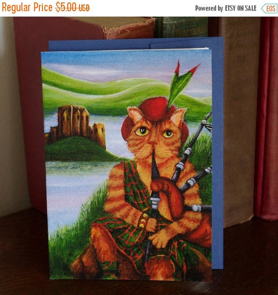 ON SALE Scottish Cat Greeting Card, Orange Tabby Cat Playing Bagpipes by Eilean Donan Castle