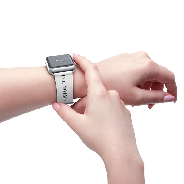 Silver Matte, white Made Inc signature Apple Watch band displaying a woman with pink finger nails pressing the crown of  with the loop holes showing on the test 2015 side of the band