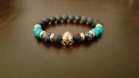 An elegantly handcrafted gold matte black onyx and turquoise bracelet - made of only the most exquisite materials found.