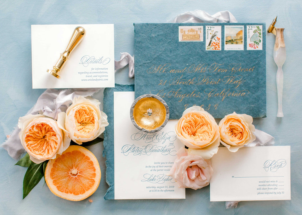 blue and blush calligraphy wedding suite in letterpress
