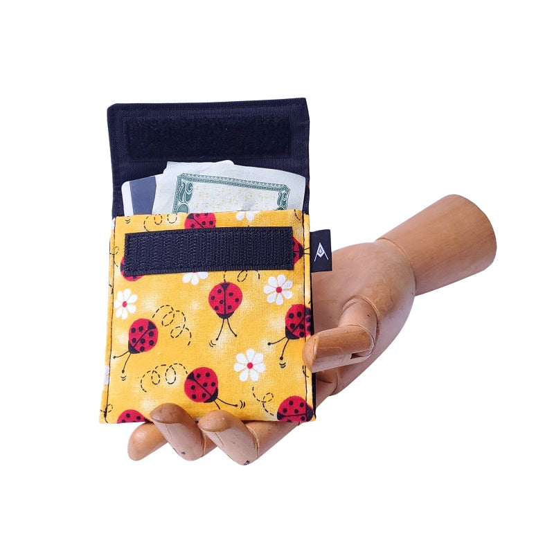 Ladybug red and yellow Print Velcro Mini Wallet by Anne Marie Beard. Handmade in Austin, Texas since 2004 y'all! annemarie mini wallet austin texas
