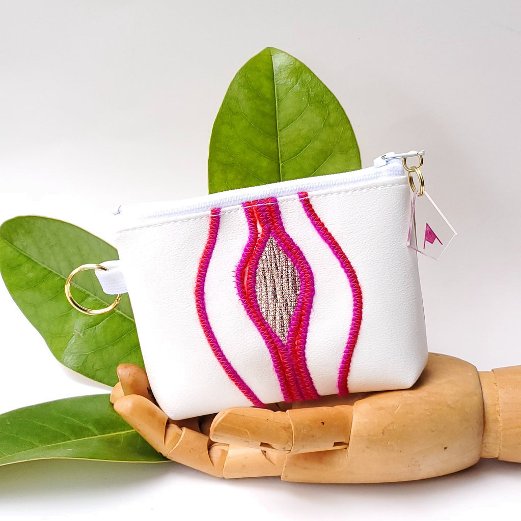 Sacred Fruit Pink and gold Embroidered Vagina Vulva Wallet by Anne Marie Beard. Handmade in Austin, Texas since 2002 y'all! annemarie mini wallet austin texas