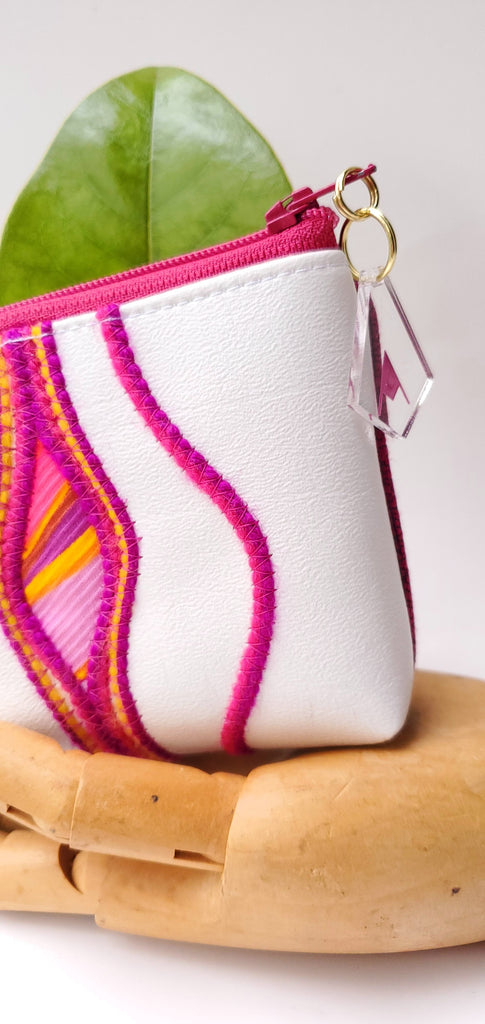 Sacred Fruit Pink embroidery on white Vagina Vulva Wallet by Anne Marie Beard. Handmade in Austin, Texas since 2002 y'all! annemarie mini wallet austin texas