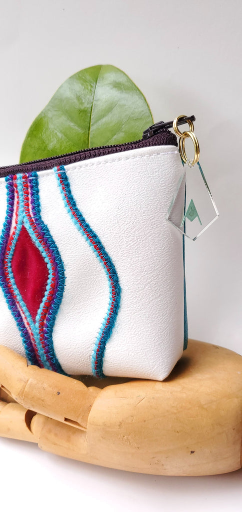 sacred fruit Plum & teal Embroidered Vagina Vulva Wallet by Anne Marie Beard. Handmade in Austin, Texas since 2002 y'all! annemarie mini wallet austin texas