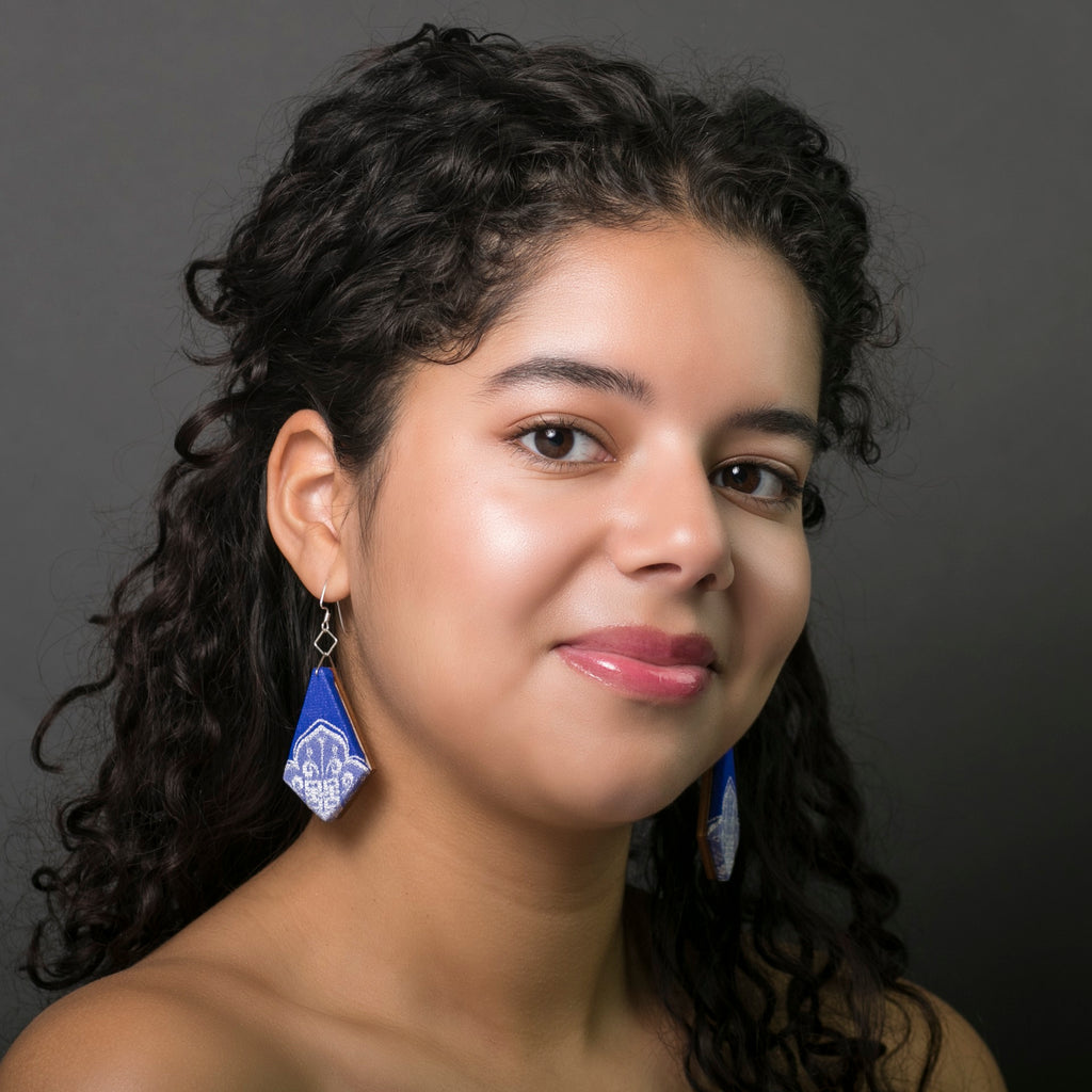 Cobalt blue textile earrings sustainably made in Austin Texas by designer Anne Marie Beard. Model Melina Perez. Photographer Rachel Boettcher.