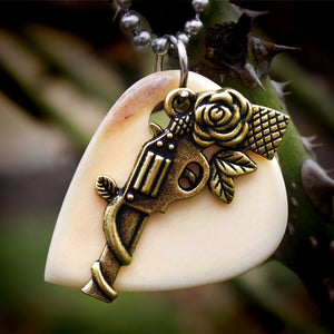 Gold Six Shooter Hand Crafted Cow Bone Guitar Pick Necklace