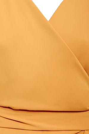 Detail shot Mustard yellow wrap tie waist maxi dress with balloon sleeves and plunging neckline