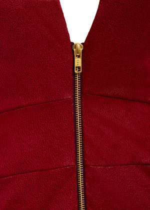 A detail view of the gold centre front zip fastening on our Alisha dress