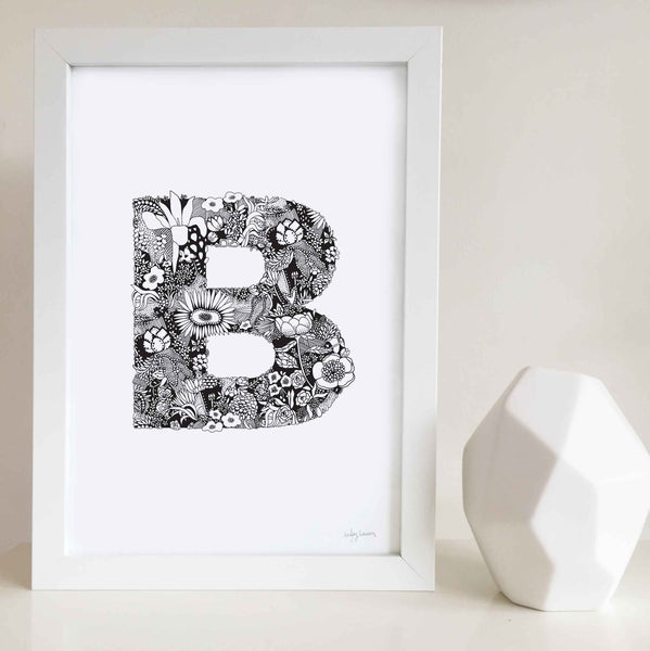The floral letter 'A' artwork was illustrated by Hayley Lauren in Melbourne, Australia. It is the perfect artwork to personalise a nursery or kids bedroom.