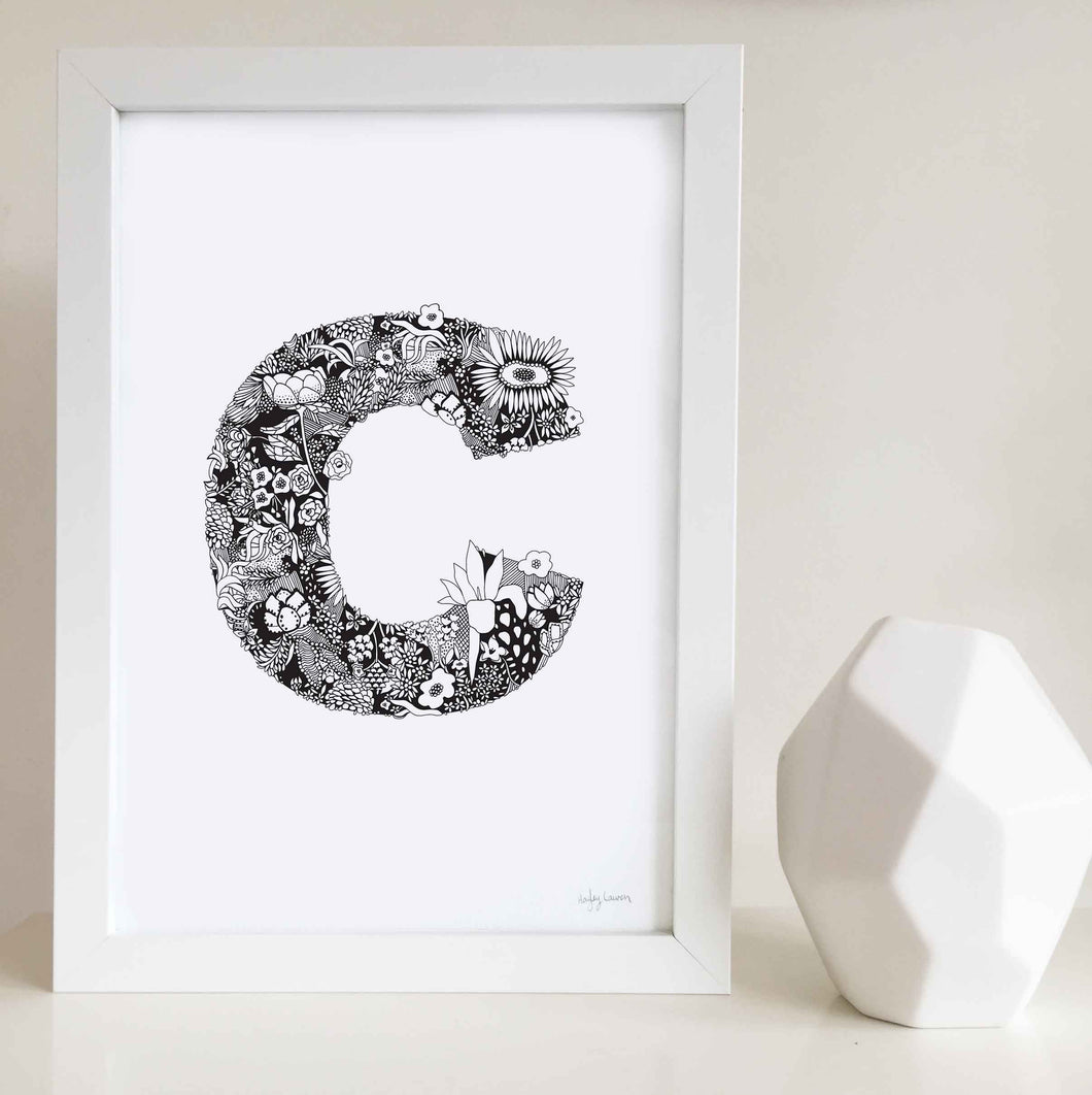 The floral letter C artwork was illustrated by Hayley Lauren in Melbourne, Australia. It is the perfect artwork to personalise a nursery or kids bedroom.