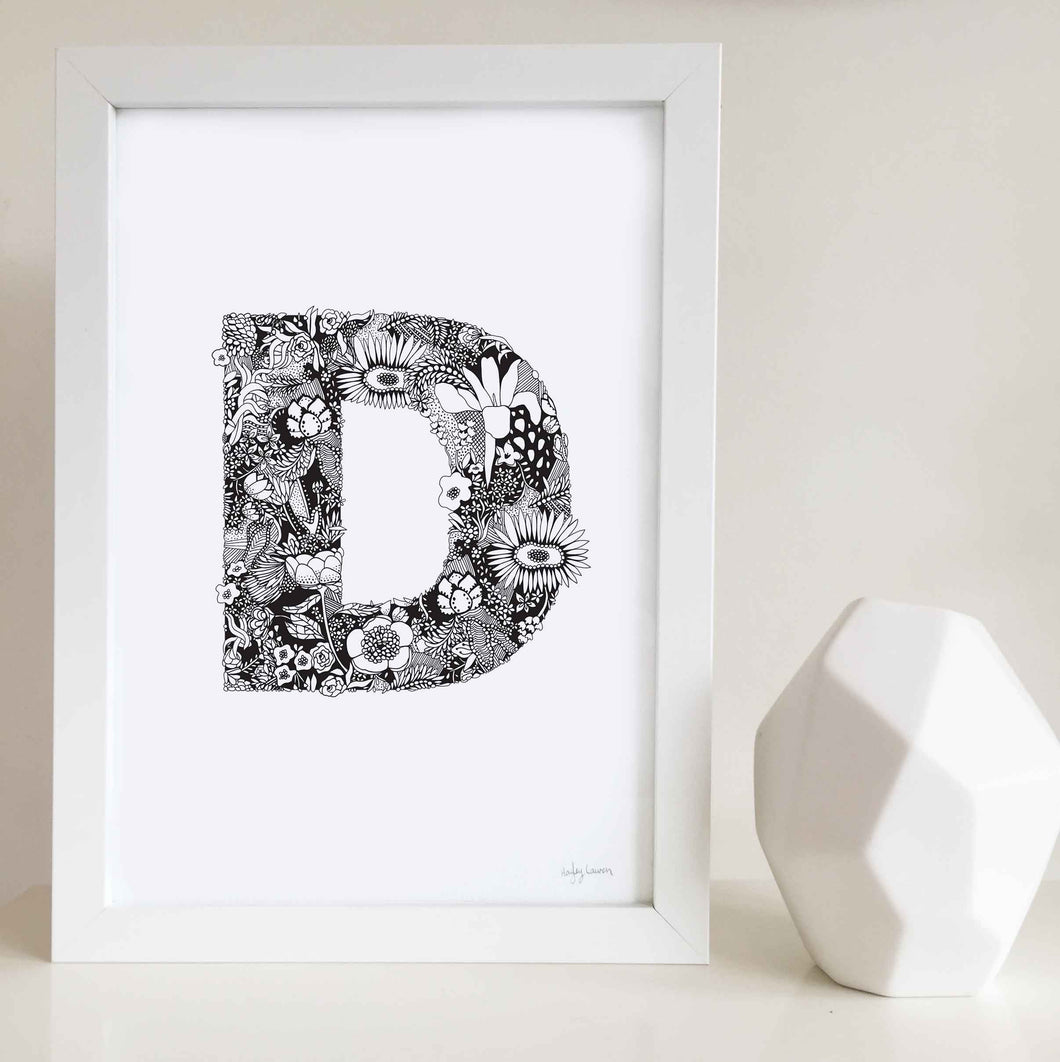 The floral letter 'D' artwork was illustrated by Hayley Lauren in Melbourne, Australia. It is the perfect artwork to personalise a nursery or kids bedroom.