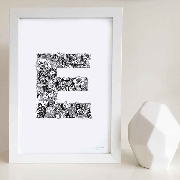 The floral letter 'E' artwork was illustrated by Hayley Lauren in Melbourne, Australia. It is the perfect artwork to personalise a nursery or kids bedroom.