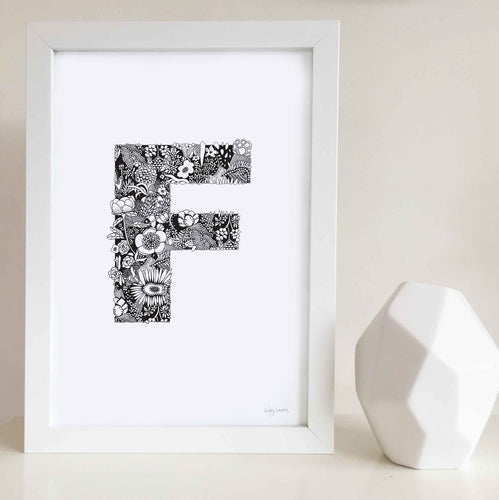 The floral letter 'F' artwork was illustrated by Hayley Lauren in Melbourne, Australia. It is the perfect artwork to personalise a nursery or kids bedroom.