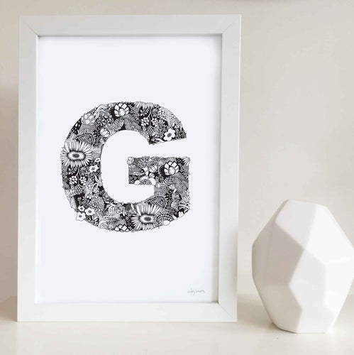 The floral letter 'G' artwork was illustrated by Hayley Lauren in Melbourne, Australia. It is the perfect artwork to personalise a nursery or kids bedroom.