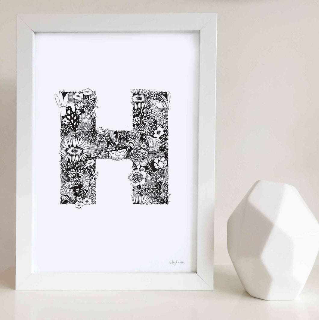 The floral letter 'H' artwork was illustrated by Hayley Lauren in Melbourne, Australia. It is the perfect artwork to personalise a nursery or kids bedroom.