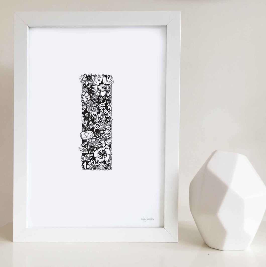 The floral letter 'I' artwork was illustrated by Hayley Lauren in Melbourne, Australia. It is the perfect artwork to personalise a nursery or kids bedroom.