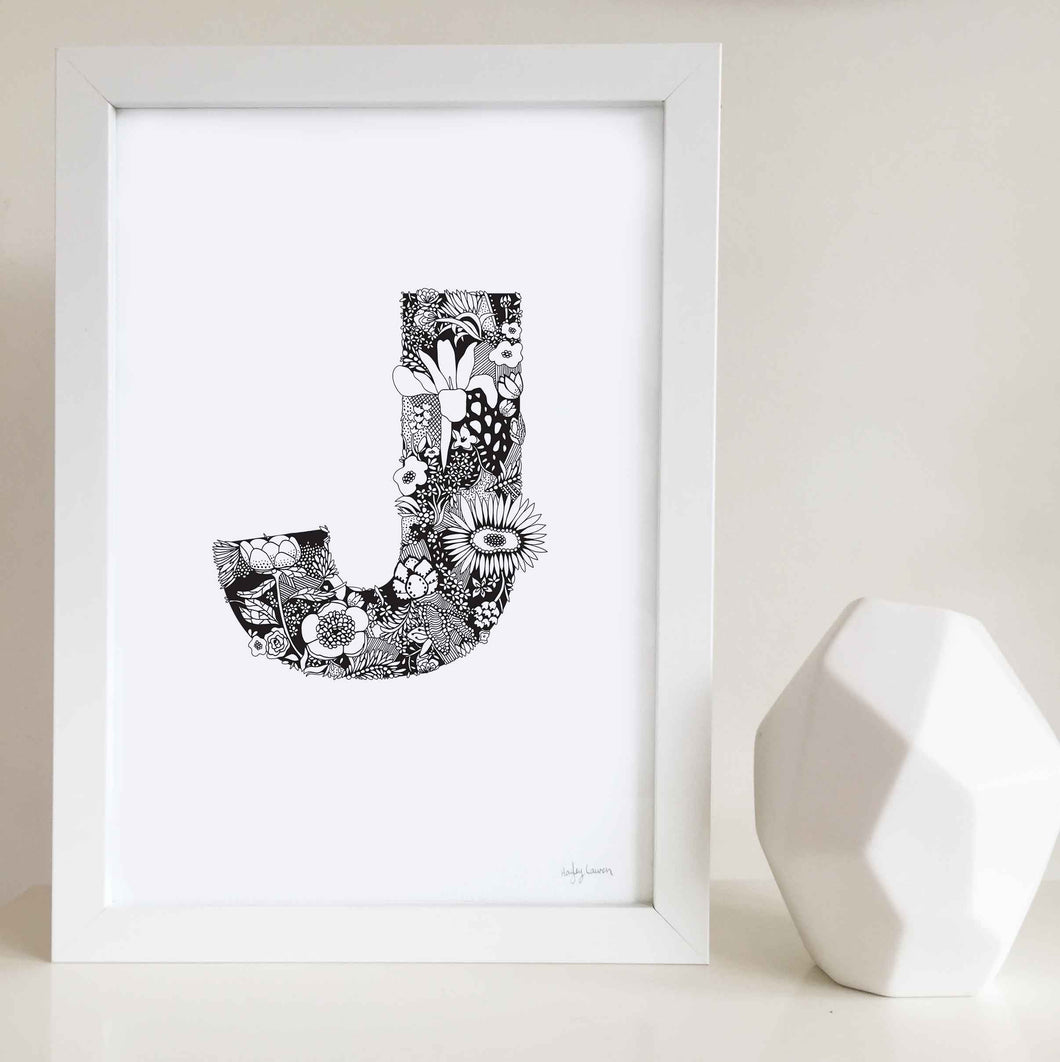 The floral letter 'J' artwork was illustrated by Hayley Lauren in Melbourne, Australia. It is the perfect artwork to personalise a nursery or kids bedroom.