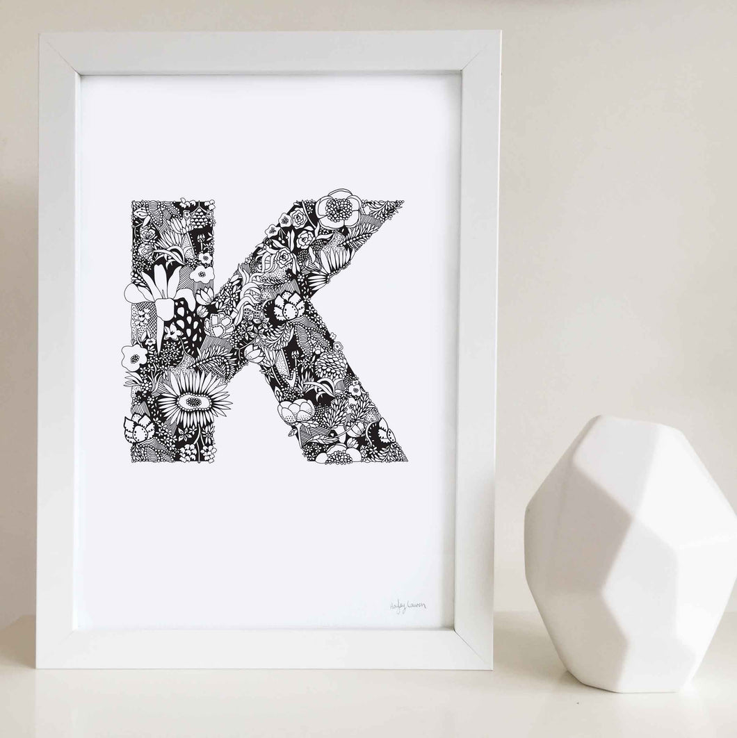 The floral letter 'K' artwork was illustrated by Hayley Lauren in Melbourne, Australia. It is the perfect artwork to personalise a nursery or kids bedroom.