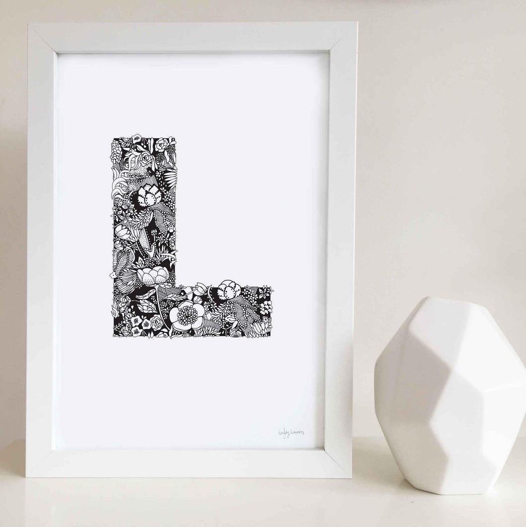 The floral letter 'L' artwork was illustrated by Hayley Lauren in Melbourne, Australia. It is the perfect artwork to personalise a nursery or kids bedroom.