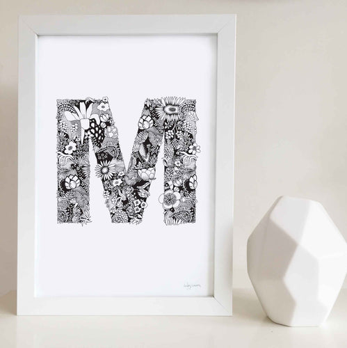 The floral letter 'M' artwork was illustrated by Hayley Lauren in Melbourne, Australia. It is the perfect artwork to personalise a nursery or kids bedroom.